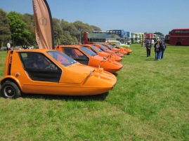 A row of 1970s three-wheeled icons The Bond Bug. Of 2,500 made 1,000 are still on the road.