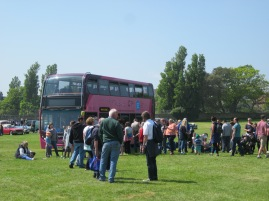 There were large crowds at the Oval to look at the cars and buses.