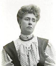 220px-Suffragette_Minnie_Baldock_1909_by_Col_B